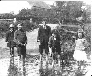 Children playing in the shallows of the Foss, 1917
