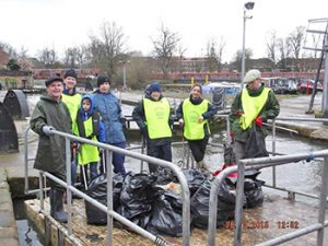 Litter pickers on the Foss Barge