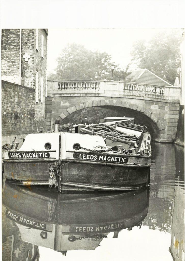Barge 'Leeds Magnetic' goes under the Foss Bridge, 1970s.