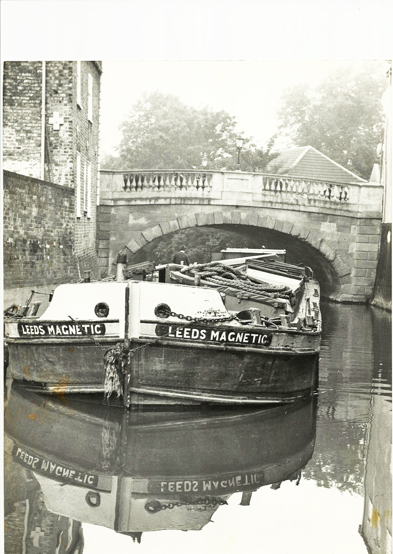 Barge 'Leeds Magnetic' goes under the Foss Bridge, 1970s.
